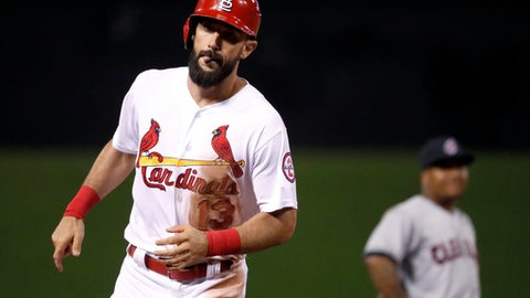 St. Louis Cardinals' Matt Carpenter, left, rounds the bases past Cleveland Indians third baseman Jose Ramirez after hitting a solo home run during the eighth inning of a baseball game Tuesday, June 26, 2018, in St. Louis. (AP Photo/Jeff Roberson)