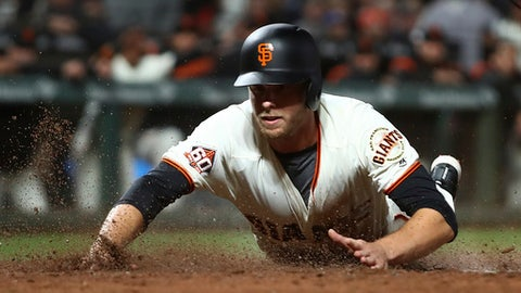 San Francisco Giants' Austin Slater scores against the Colorado Rockies during the seventh inning of a baseball game Tuesday, June 26, 2018, in San Francisco. Slater scored on a sacrifice fly by Andrew McCutchen. (AP Photo/Ben Margot)