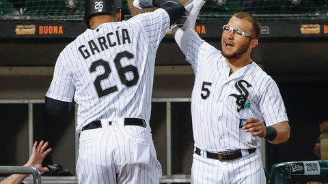 Chicago White Sox's Avisail Garcia, left, celebrates with Yolmer Sanchez after hitting a solo home run off Minnesota Twins' Alan Busenitz during the seventh inning of a baseball game, Tuesday, June 26, 2018, in Chicago. (AP Photo/Kamil Krzaczynski)