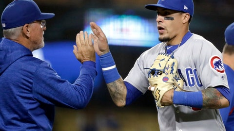 Chicago Cubs third baseman Javier Baez, right, celebrates with manager Joe Maddon after the team's 9-4 win over the Los Angeles Dodgers in a baseball game in Los Angeles, Tuesday, June 26, 2018. (AP Photo/Chris Carlson)