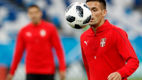 """FILE - In this Thursday, June 21, 2018 file photo, Serbia's Dusan Tadic watches the ball at the official training session of the Serbian team at the 2018 soccer World Cup at Kaliningrad stadium in Kaliningrad, Russia. Serbia's World Cup midfielder Dusan Tadic is leaving Southampton next month to join former European Cup champion Ajax. """"Southampton Football Club can confirm that Dusan Tadic has agreed a move to Ajax for an undisclosed fee,"""" the Premier League club said on Wednesday, June 27, 2018. """"The transfer sees the 29-year-old move back to the Dutch top flight four years after joining Saints from FC Twente."""" (AP Photo/Antonio Calanni)"""