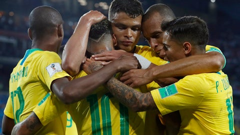 Brazil's players celebrates after teammate Brazil's Thiago Silva, center, scored his side's second goal during the group E match between Serbia and Brazil, at the 2018 soccer World Cup in the Spartak Stadium in Moscow, Russia, Wednesday, June 27, 2018. (AP Photo/Rebecca Blackwell)