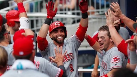 Cincinnati Reds second baseman Jose Peraza (9) celebrates with Scooter Gennett, right, in the dugout after hitting a solo-home run in the third inning of a baseball game against the Atlanta Braves Wednesday, June 27, 2018, in Atlanta. (AP Photo/John Bazemore)