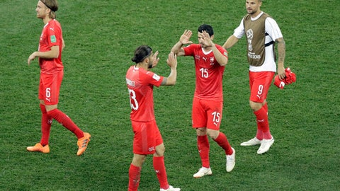 Switzerland players celebrate at the end of the group E match between Switzerland and Costa Rica, at the 2018 soccer World Cup in the Nizhny Novgorod Stadium in Nizhny Novgorod , Russia, Wednesday, June 27, 2018. (AP Photo/Mark Baker)