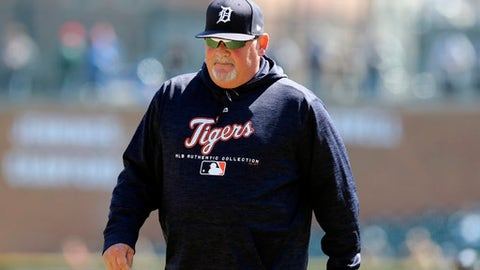 FILE- In an April 20, 2018 file photo Detroit Tigers pitching coach Chris Bosio walks to the dugout during the seventh inning of game one of a baseball doubleheader against the Kansas City Royals in Detroit. The Tigers have fired Bosio saying his contract was terminated for insensitive comments that were in violation of team policy and his contract. The team says it holds employees to the highest standards of personal conduct on and off the field, adding it has zero tolerance for Bosio's behavior. (AP Photo/Carlos Osorio, File)