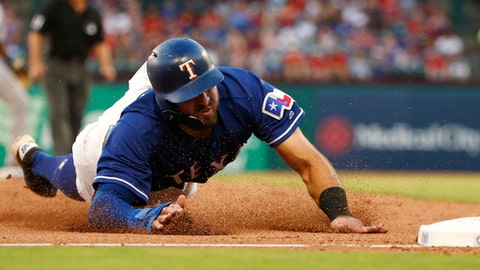Texas Rangers' Joey Gallo slides safely into third base after a single by Shin-Soo Choo against the San Diego Padres during the fourth inning of a baseball game Wednesday, June 27, 2018, in Arlington, Texas. (AP Photo/Ron Jenkins)