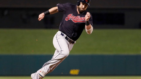 Cleveland Indians' Jason Kipnis rounds third and heads home to score during the sixth inning against the St. Louis Cardinals in a baseball game Wednesday, June 27, 2018, in St. Louis. (AP Photo/Jeff Roberson)