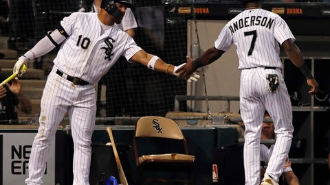 Chicago White Sox's Tim Anderson, right, celebrates after scoring a run, with teammate Yoan Moncada during the sixth inning of a baseball game against the Minnesota Twins on Wednesday, June 27, 2018, in Chicago. (AP Photo/Jim Young)