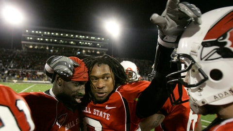 FILE - In this Nov. 25, 2008, file photo, Ball State linebacker Wendell Brown, left, stands with cornerback Trey Buice near the end of an NCAA college football game in Muncie, Ind. A lawyer for former Ball State football player Brown said Thursday, June 28, 2018, that a Chinese court has sentenced the Detroit native to four years' prison for his involvement in a September 2016 bar fight. (AP Photo/Darron Cummings, File)
