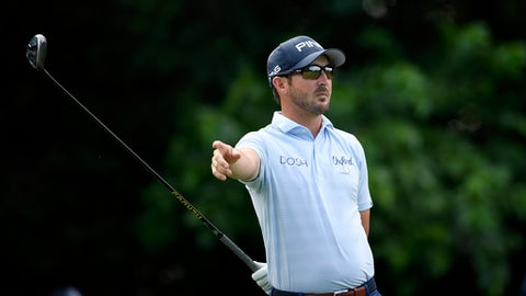 Andrew Landry gestures after his tee shot on the 16th tee during the first round of the Quicken Loans National golf tournament, Thursday, June 28, 2018, in Potomac, Md. (AP Photo/Nick Wass)