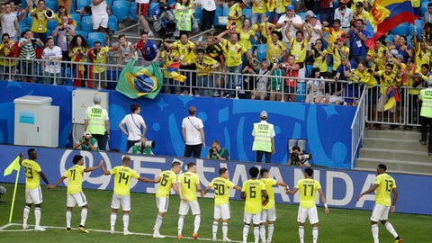 Colombia's Yerry Mina, right, celebrates with his teammates after scoring his side's first goal during the group H match between Senegal and Colombia, at the 2018 soccer World Cup in the Samara Arena in Samara, Russia, Thursday, June 28, 2018. (AP Photo/Gregorio Borgia)