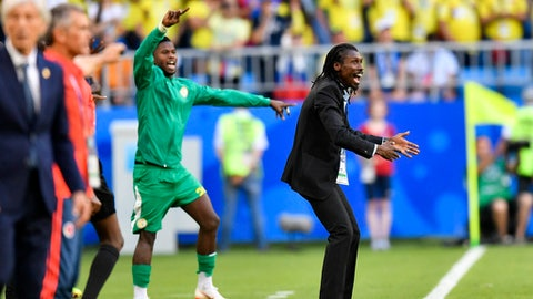 Senegal coach Aliou Cisse, right, gestures during the group H match between Senegal and Colombia, at the 2018 soccer World Cup in the Samara Arena in Samara, Russia, Thursday, June 28, 2018. (AP Photo/Martin Meissner)