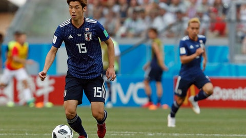 Japan's Yuya Osako controls the ball during the group H match between Japan and Poland at the 2018 soccer World Cup at the Volgograd Arena in Volgograd, Russia, Thursday, June 28, 2018. (AP Photo/Darko Vojinovic)