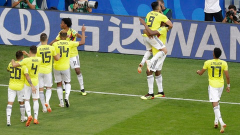 Colombia's Yerry Mina, second from right, celebrates with his teammates after scoring his side's first goal during the group H match between Senegal and Colombia, at the 2018 soccer World Cup in the Samara Arena in Samara, Russia, Thursday, June 28, 2018. (AP Photo/Gregorio Borgia)