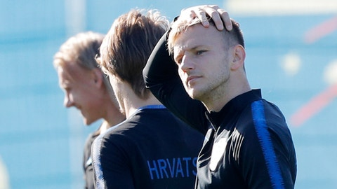 Croatia's Ivan Rakitic, right, attends Croatia's official training in Roschino near St. Petersburg, Russia, Thursday, June 28, 2018, at the 2018 soccer World Cup. (AP Photo/Dmitri Lovetsky)