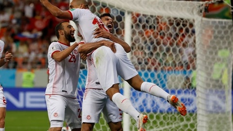 Tunisia's Wahbi Khazri celebrates with his teammates after scoring his side's second goal during the group G match between Panama and Tunisia at the 2018 soccer World Cup at the Mordovia Arena in Saransk, Russia, Thursday, June 28, 2018. (AP Photo/Darko Bandic)