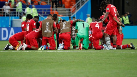 Panama players kneel in prayer after losing 1-2 in the group G match between Panama and Tunisia at the 2018 soccer World Cup in the Mordovia Arena in Saransk, Russia, Thursday, June 28, 2018. (AP Photo/Pavel Golovkin)
