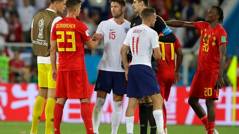 England's Gary Cahill shakes hands with Belgium's Leander Dendoncker, 2nd left, at the end of the group G match between England and Belgium at the 2018 soccer World Cup in the Kaliningrad Stadium in Kaliningrad, Russia, Thursday, June 28, 2018. (AP Photo/Alastair Grant)
