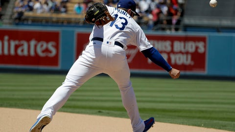 Los Angeles Dodgers first baseman Max Muncy can't get a glove on a single by Chicago Cubs' Albert Almora Jr. during the seventh inning of a baseball game in Los Angeles, Thursday, June 28, 2018. (AP Photo/Chris Carlson)