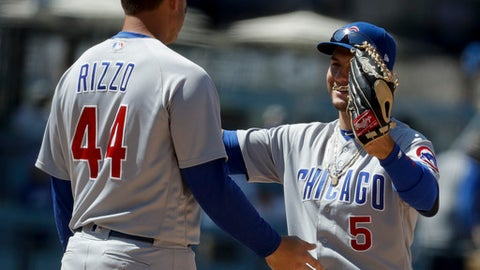 Chicago Cubs first baseman Anthony Rizzo, left, and center fielder Albert Almora Jr. celebrate their 11-5 win against the Los Angeles Dodgers during a baseball game in Los Angeles, Thursday, June 28, 2018. (AP Photo/Chris Carlson)