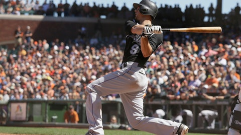 Colorado Rockies' DJ LeMahieu hits a two-run home run off San Francisco Giants relief pitcher Sam Dyson in the ninth inning of a baseball game Thursday, June 28, 2018, in San Francisco. (AP Photo/Eric Risberg)