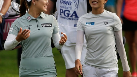 Lydia Ko, right, of New Zealand, smiles as she listens to So Yeon Ryu, of South Korea, as they walk to the ninth hole during the first round of the KPMG Women's PGA Championship golf tournament at Kemper Lakes Golf Club near Kildeer, Ill., Thursday, June 28, 2018. (AP Photo/Nam Y. Huh)