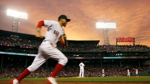 Boston Red Sox's Mookie Betts takes the field at the top of the fifth inning of the team's baseball game against the Los Angeles Angels in Boston, Thursday, June 28, 2018. (AP Photo/Michael Dwyer)