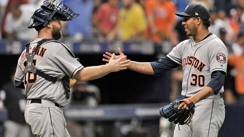 Houston Astros catcher Brian McCann, left, celebrates with closer Hector Rondon (30) at the end of a 1-0 win over the Tampa Bay Rays during a baseball game Thursday, June 28, 2018, in St. Petersburg, Fla. (AP Photo/Steve Nesius)