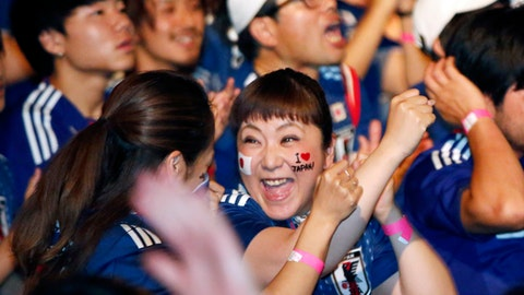 In this Thursday, June 28, 2018, file photo,  Japanese soccer fans celebrate at a public viewing venue in Tokyo as Japan advanced to the next stage of the World Cup following their team's loss to Poland in the Group H World Cup soccer match. (AP Photo/Shuji Kajiyama, File)
