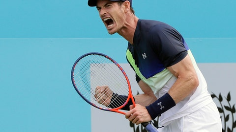 FILE - In this June 19, 2018, file photo, Andy Murray of Britain celebrates winning a point after he plays a return to Nick Kyrgios of Australia during their singles tennis match at the Queen's Club tennis tournament in London. Murray is expected to compete in the Wimbledon tennis tournament that begins Monday, July 2, 2018.  (AP Photo/Kirsty Wigglesworth, File)
