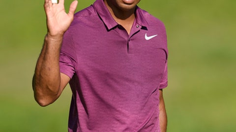 Tiger Woods waves on the 10th green during the second round of the Quicken Loans National golf tournament, Friday, June 29, 2018, in Potomac, Md. (AP Photo/Nick Wass)
