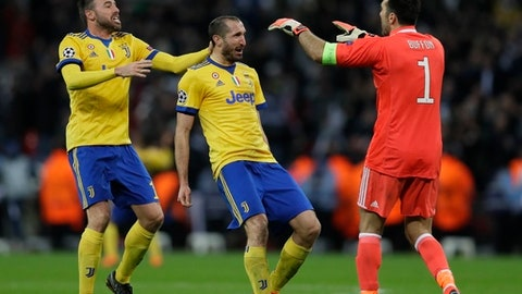 FILE - In this file photo taken at the Wembley Stadium in London on March 7, 2018, from left, Juventus' Andrea Barzagli, Giorgio Chiellini and Gianluigi Buffon celebrate their side's 2-1 win, at the end of the the Champions League match between Juventus and Tottenham Hotspur.  Juventus defenders Giorgio Chiellini and Andrea Barzagli have extended their contracts with the Serie A champion. Chiellini, the new captain following the departure of veteran goalkeeper Gianluigi Buffon, arrived at Juve in 2005 and Barzagli joined in 2011. (AP Photo/Kirsty Wigglesworth)