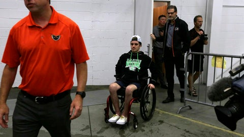Ryan Straschnitzki wheels into the Skate Zone, the Philadelphia Flyers practice facility, Friday June 29, 2018 in Voorhees, N.J. Straschnitzki, a young hockey player who was paralyzed in the Humboldt Broncos bus crash in Canada has been in Philadelphia receiving specialized spinal treatment. The 19-year-old was paralyzed from the chest down when a bus carrying the Saskatchewan junior hockey team was in a collision with a semi-trailer on a rural highway April 6. (AP Photo/Jacqueline Larma)