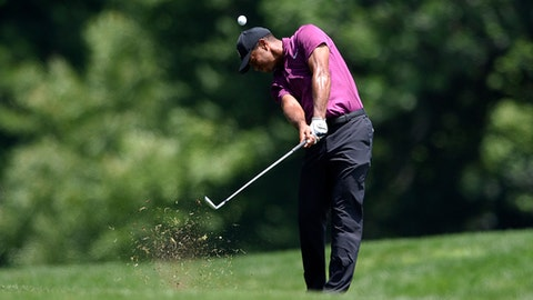 Tiger Woods hits from the rough on the seventh hole during the second round of the Quicken Loans National golf tournament, Friday, June 29, 2018, in Potomac, Md. (AP Photo/Nick Wass)