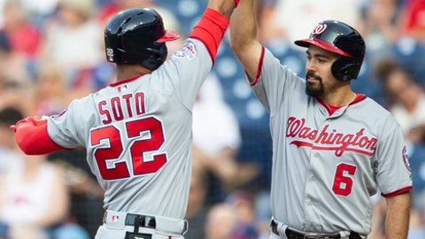 Washington Nationals' Juan Soto (22) high-fives Anthony Rendon (6) after hitting a two-run home run in the first inning of the team's baseball game against the Philadelphia Phillies, Friday, June 29, 2018, in Philadelphia. (AP Photo/Laurence Kesterson)
