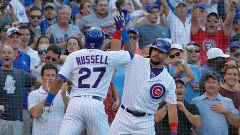 Chicago Cubs' Addison Russell, left, celebrates his grand slam with Kyle Schwarber during the fifth inning of a baseball game against the Minnesota Twins on Friday, June 29, 2018, in Chicago. (AP Photo/Jim Young)