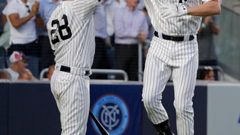 New York Yankees' Greg Bird, right, celebrates with Austin Romine (28) after hitting a solo home run against the Boston Red Sox during the fourth inning of a baseball game Friday, June 29, 2018, in New York. (AP Photo/Julie Jacobson)