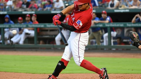 Texas Rangers' Shin-Soo Choo connects on a two-run home run off Chicago White Sox relief pitcher Chris Volstad during the third inning of a baseball game Friday, June 29, 2018, in Arlington, Texas. Choo's home run was the Rangers' fifth of the game. (AP Photo/Jeffrey McWhorter)