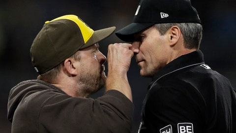 San Diego Padres manager Andy Green, left, argues with home plate umpire Angel Hernandez before being ejected between the third and fourth innings of the team's baseball game against the Pittsburgh Pirates on Friday, June 29, 2018, in San Diego. (AP Photo/Gregory Bull)