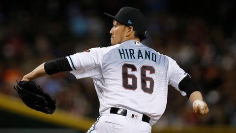 Arizona Diamondbacks relief pitcher Yoshihisa Hirano, of Japan, throws a pitch to the San Francisco Giants during the seventh inning of a baseball game Friday, June 29, 2018, in Phoenix. (AP Photo/Ross D. Franklin)