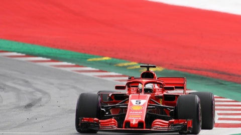 Ferrari driver Sebastian Vettel of Germany takes a curve during the third free practice session for the Austrian Formula One Grand Prix at the Red Bull Ring racetrack in Spielberg, southern Austria, Saturday June 30, 2018. The race will be held on Sunday. (AP Photo/Ronald Zak)