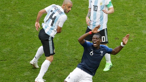 France's Paul Pogba, front, falls beside Argentina's Javier Mascherano, left, and Lionel Messi during the round of 16 match between France and Argentina, at the 2018 soccer World Cup at the Kazan Arena in Kazan, Russia, Saturday, June 30, 2018. (AP Photo/Sergei Grits)