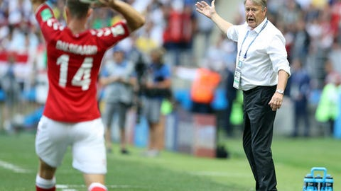 FILE - In this file photo from  June 26, 2018, Denmark coach Age Hareide, right, gestures during the Group C match between Denmark and France at the 2018 World Cup at the Luzhniki Stadium in Moscow, (AP Photo/David Vincent, File)