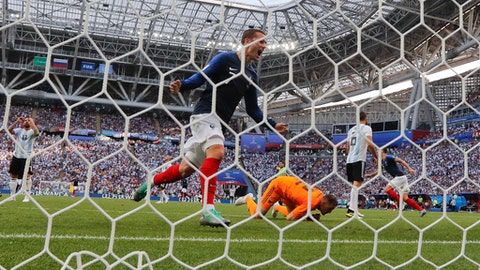 France's Antoine Griezmann celebrates after France's Benjamin Pavard scored their side's second goal, during the round of 16 match between France and Argentina, at the 2018 soccer World Cup at the Kazan Arena in Kazan, Russia, Saturday, June 30, 2018. (AP Photo/Frank Augstein)