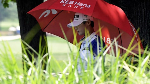 Sung Hyun Park, of South Korea, walks to the tee box on the second hole during the third round of the KPMG Women's PGA Championship golf tournament at Kemper Lakes Golf Club in Kildeer, Ill., Saturday, June 30, 2018. (AP Photo/David Banks)