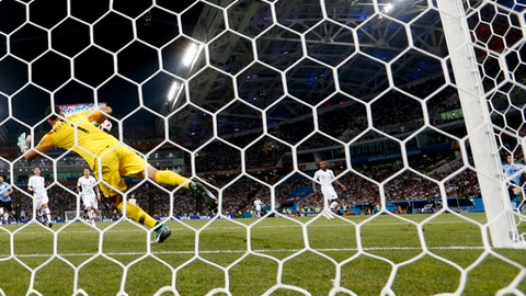 Portugal goalkeeper Rui Patricio fails to block as Uruguay's Edinson Cavani, right, scores his side' second goal, during the round of 16 match between Uruguay and Portugal at the 2018 soccer World Cup at the Fisht Stadium in Sochi, Russia, Saturday, June 30, 2018. (AP Photo/Andre Penner)