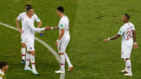 Portugal's Cristiano Ronaldo, left, and Portugal's Jose Fonte shake hand after their team was eliminated during the round of 16 match between Uruguay and Portugal at the 2018 soccer World Cup at the Fisht Stadium in Sochi, Russia, Saturday, June 30, 2018. (AP Photo/Darko Vojinovic)