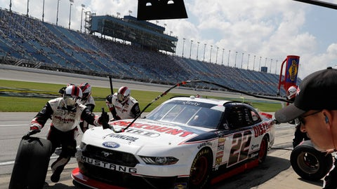 Paul Menard makes a pit stop during a NASCAR Xfinity Series auto race at Chicagoland Speedway in Joliet, Ill., Saturday, June 30, 2018. (AP Photo/Nam Y. Huh)