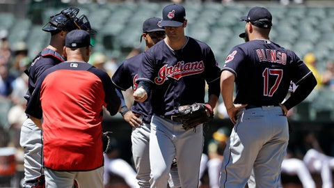 Cleveland Indians starting pitcher Adam Plutko, center, is pulled from the game by manager Terry Francona, left, during the sixth inning of a baseball game against the Oakland Athletics ,Saturday, June 30, 2018, in Oakland, Calif. (AP Photo/Marcio Jose Sanchez)