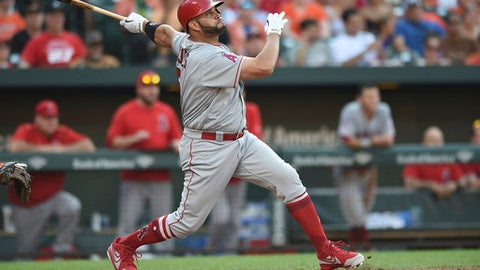 Los Angeles Angels' Albert Pujols follows through on an RBI double to tie the score against the Baltimore Orioles during the eighth inning of baseball game Saturday, June 30, 2018, in Baltimore. (AP Photo/Gail Burton)